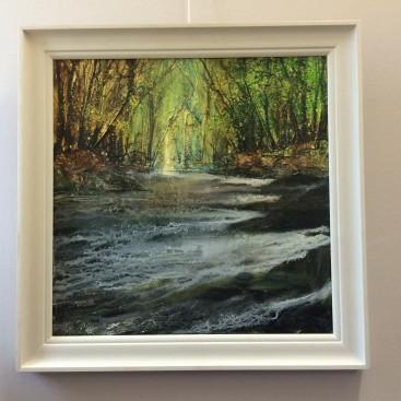River through dappled woods